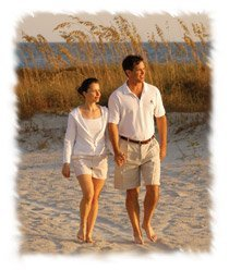 David Love and Kathy Love waling on the beach in Sea Pines